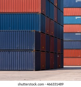 Colourful stack pattern of cargo shipping containers in shipping yard or dock yard for logistic import and export industrial