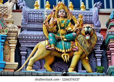 Colourful statues of Hindu religious deities adorning the entrance of a Hindu temple in Little India close up