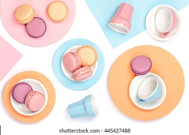 colourful still life with french dessert macaroons on white background top view. creative flat lay concept