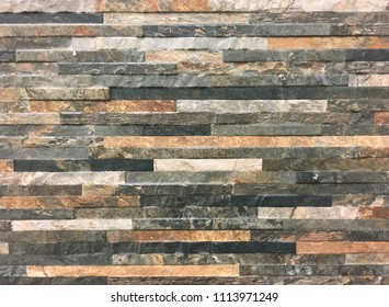 Colourful stone tiles for home improvements to a kitchen splash back or bathroom wall. Interior design full frame background.