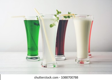 Colourful summer drinks from India like Lemon Juice, Khus sherbat, rooh/ruh afza, lassi/lassie, Kokum sharbat served together in clear glasses, selective
