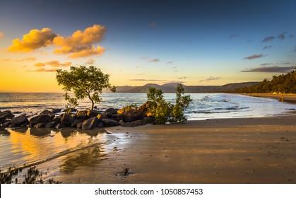 colourful sunrise 4 mile beach tropical Port Douglas Coral sea clear calm ocean morning north queensland