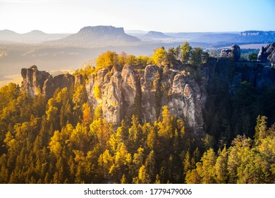 Colourful sunrise at the Bastei bridge above the Elbe River in the Elbe Sandstone Mountains of Germany. One of the most spectacular hiking regions.