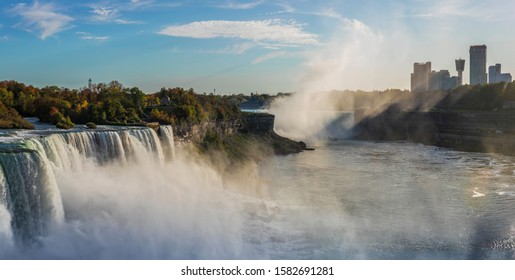 Colourful Sunrise at Niagara Falls. Niagara Falls is a group of three waterfalls at the southern end of Niagara Gorge, between the Canadian province of Ontario and the US state of New York