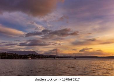 Colourful sunrise over North West Bay,Coningham.Mount Wellington in the distance.South East Coast of Tasmania,Australia.