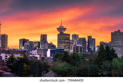Colourful sunset behind the downtown Vancouver Skyline.