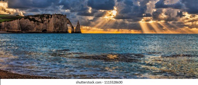 Colourful sunset at Etretat in the Upper Normandy in the North of France.The rocks formation is called L'Aiguille.