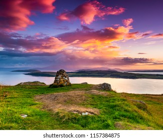 Colourful sunset looking over the Cumbrae Isles towards Arran, on the West coast of Scotland.
