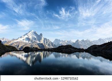 Colourful sunset on Lac Blanc lake in France Alps. Monte Bianco mountain range on background. Vallon de Berard Nature Preserve, Chamonix, Graian Alps