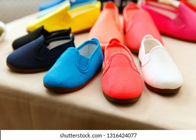Colourful textile slip on shoes