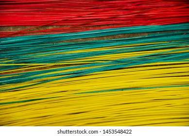 Colourful thinner bamboo sticks isolated object photo