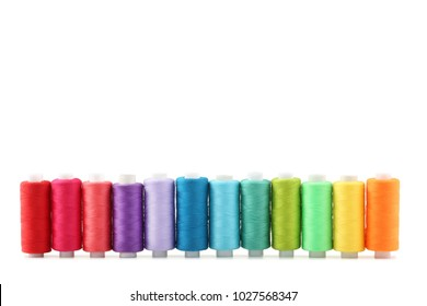 Colourful thread spools isolated on a white