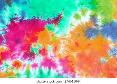colourful tie dyed pattern on cotton fabric background.
