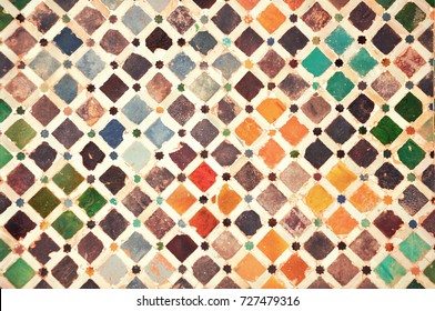 Colourful tiles in the Moorish palace of Alhambra, Granada, Spain