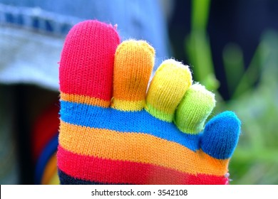 colourful toesocks in lawn above perspective