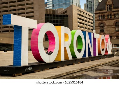 Colourful Toronto sign at Nathan Phillips square in Toronto, Canada.  The Square is used regularly for art exhibits, concerts, rallies and other ceremonies.