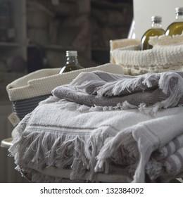 Colourful towels in a shelf.