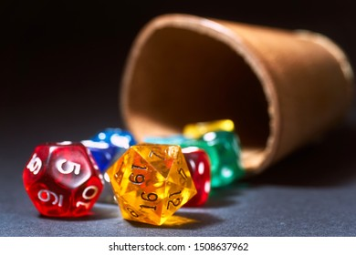 colourful transparent dice with a dice cup