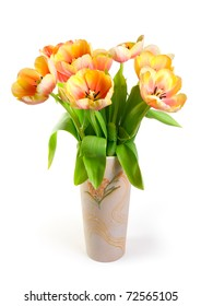 Colourful tulips in ceramic vase on a white background. Isolated path included.
