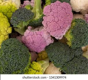 Colourful vegetables background .Raw cauliflower, broccoli florets. Healthy assortment.