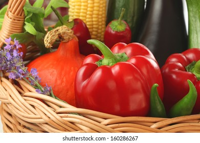 Colourful vegetables and flowers inside the basket