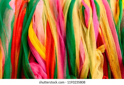 Colourful vibrant nylon ribbons abtract graphic pattern background