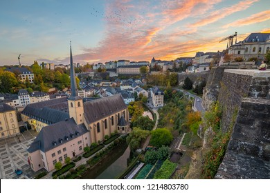 A colourful view of the Luxembourg Skyline at sunset.  Part of the Grund and Corniche can be seen.