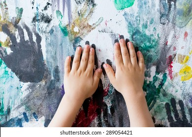 colourful wall painted with finger prints by children in kindergarten