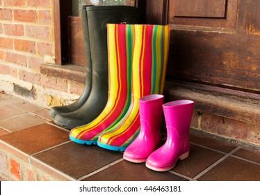 Colourful wellington boots left outside on a doorstep