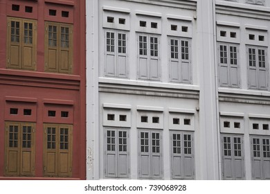 Colourful window shutters of a traditional Chinese Peranakan house in Chinatown, Singapore