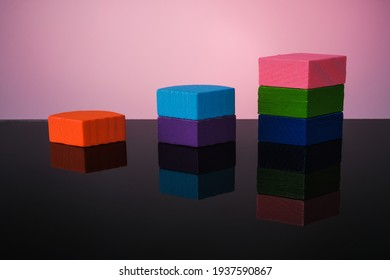 Colourful  wood block   on glass table with reflection .