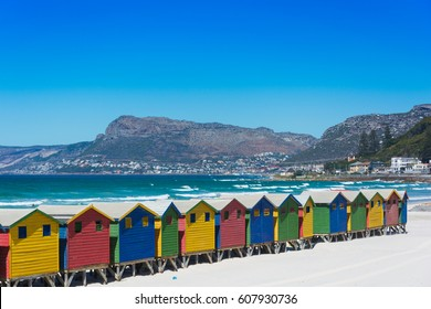 Colourful wooden beach huts on the beach at Muizenberg, Cape Town