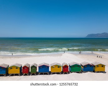Colourful wooden beach huts as seen from above on the beach at Muizenberg near Cape Town, South Africa.