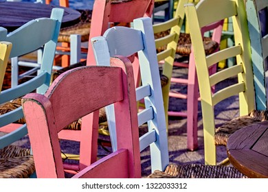 Colourful wooden chairs outdoors. Stock Photo