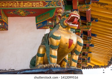 The colourful wooden figure of a snow lion decorating the Buddhist temple Dzhokang in Lhasa. Sacred place for Buddha pupils making piligrimage in Asia. Place of prayer, calm and meditation.