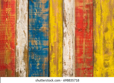 Colourful wooden panels with distressed look.