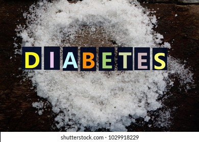 Colourful word DIABETES and sugar on wooden background