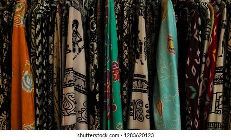 Colourfull batik shirts on a store display