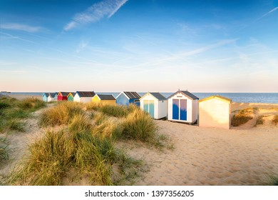 Colourfull beach huts in the sand dunes at Southwold a pretty seaside town in Suffolk