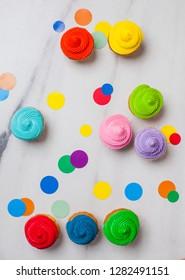 Colourfull cupcakes flat lay with vivid circles