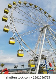 Colourfull ferris wheel with sky in the background.