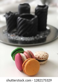 Colourfull macarons against blurry candle background