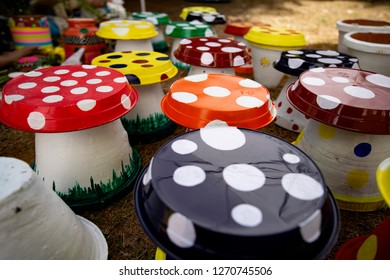 Colourfull mushrooms crafted by using flowerpots and plastic plates upside down