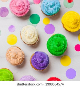 Colourfull rainbow cupcakes with confetti flat lay
