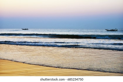 Colours of sunrise on the sea. At the Puri sea beach, Odisha, India.