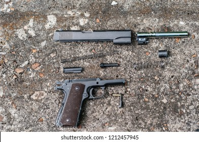 colt 45, 1911 disassembled , semi-automatic military pistol.classic pistol. close-up. training disassembly and assembly of weapons