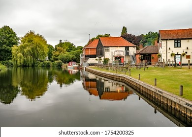 Coltishall, Norfolk, UK – June 10 2020. The Rising Sun pub on the River Bure in the village of Coltishall in the heart of the Norfolk Broads