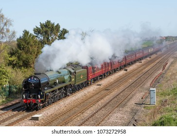 COLTON JUNCTION, ENGLAND APRIL 20, 2018 Former Southern Railway Merchant Navy Class steam locomotive 35018 British India Line in its British Railways livery pulling an excursion train.