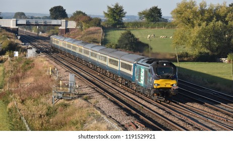 Colton York Uk Sept 29th 2018 loco hauled passenger charter train destination Carlisle, passes through Yorkshire countryside at Colton South Junction, with a rake of blue and grey MK2 carriages