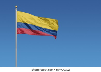 Columbia Flag in front of a clear blue sky